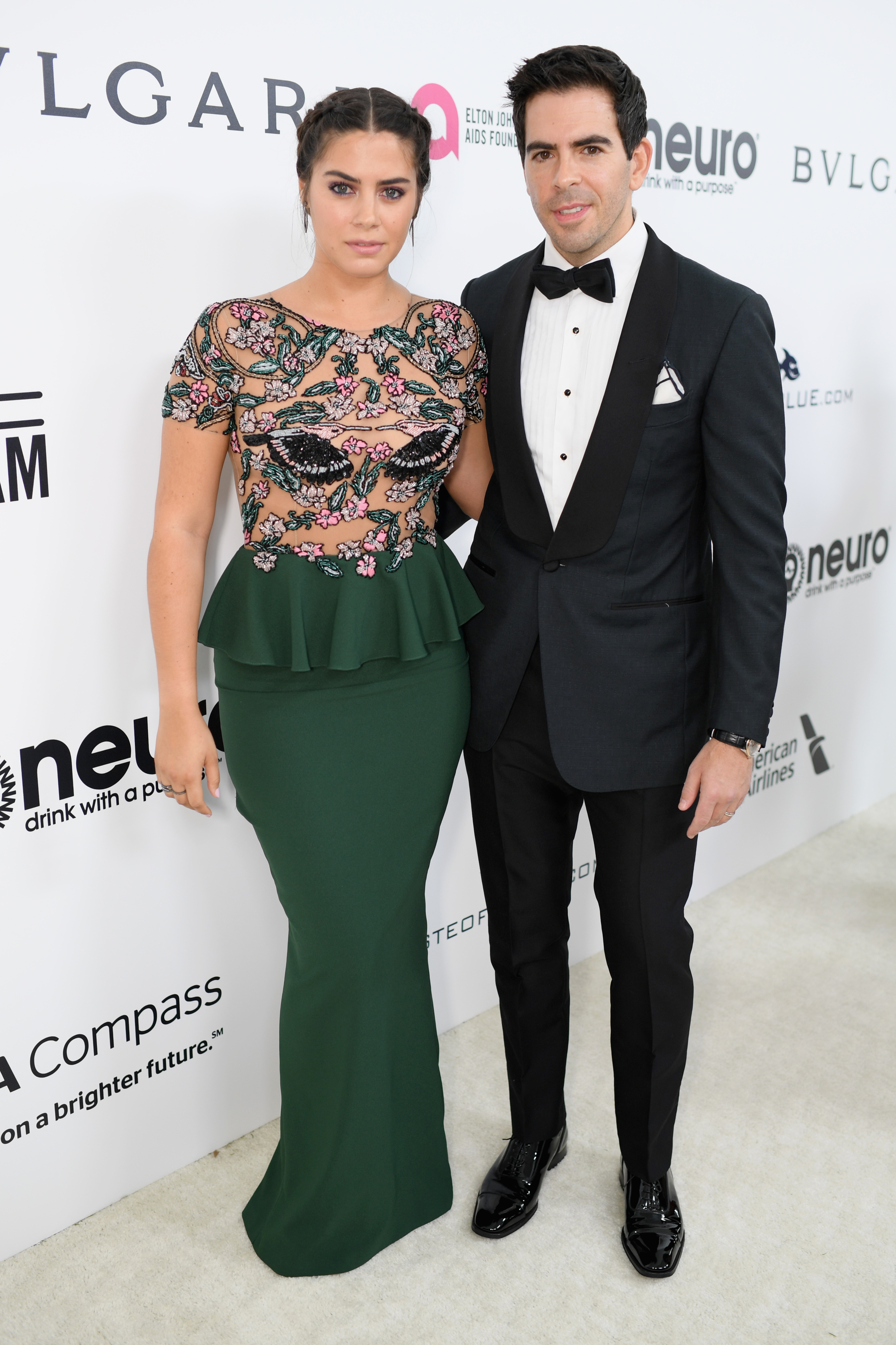 Director Eli Roth (R) and Lorenza Izzo attend the 25th Annual Elton John AIDS Foundation's Academy Awards Viewing Party at The City of West Hollywood Park on February 26, 2017 in West Hollywood, California.