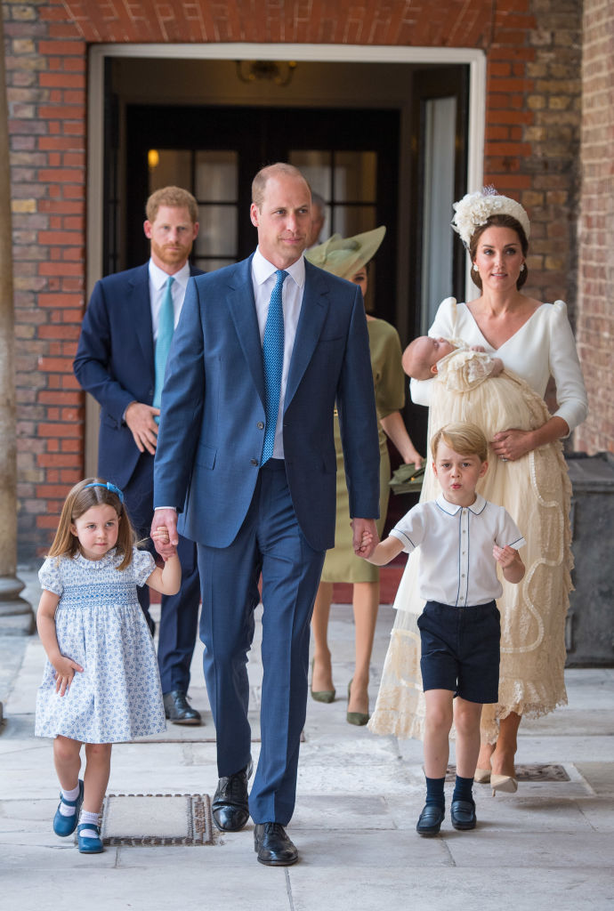 Princess Charlotte and Prince George hold the hands of their father, Prince William, as they arrive at the Chapel Royal, St James's Palace, London for the christening of their brother, Prince Louis, who is being carried by their mother, Catherine, Duchess of Cambridge on July 9, 2018 in London. (Photo by Dominic Lipinski - WPA Pool/Getty Images)