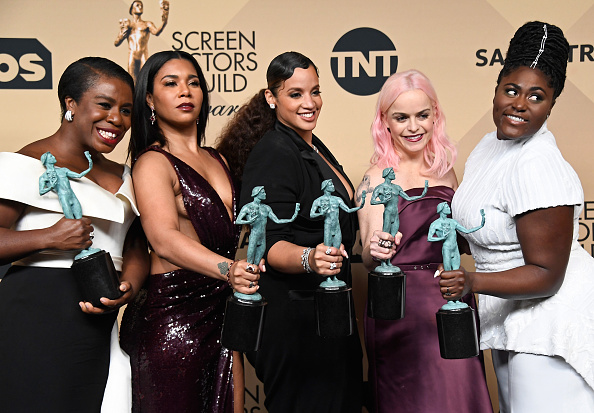 Cast of 'Orange is the New Black' pick the trophy for Outstanding Performance by an Ensemble in a Comedy Series at 23rd Annual Screen Actors Guild Awards. (Getty Images)