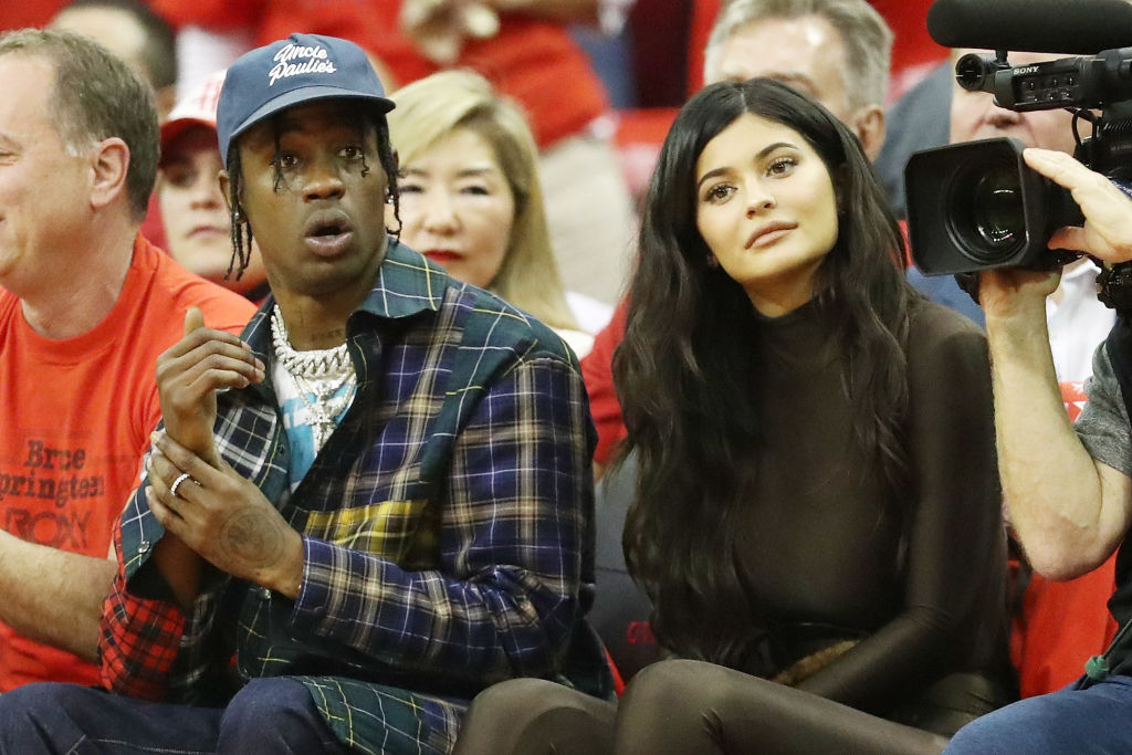 Travis Scott and Kylie Jenner attend Game Seven of the Western Conference Finals of the 2018 NBA Playoffs between the Houston Rockets and the Golden State Warriors at Toyota Center on May 28, 2018 in Houston, Texas. NOTE TO USER: User expressly acknowledges and agrees that, by downloading and or using this photograph, User is consenting to the terms and conditions of the Getty Images License Agreement. (Photo by Ronald Martinez/Getty Images)