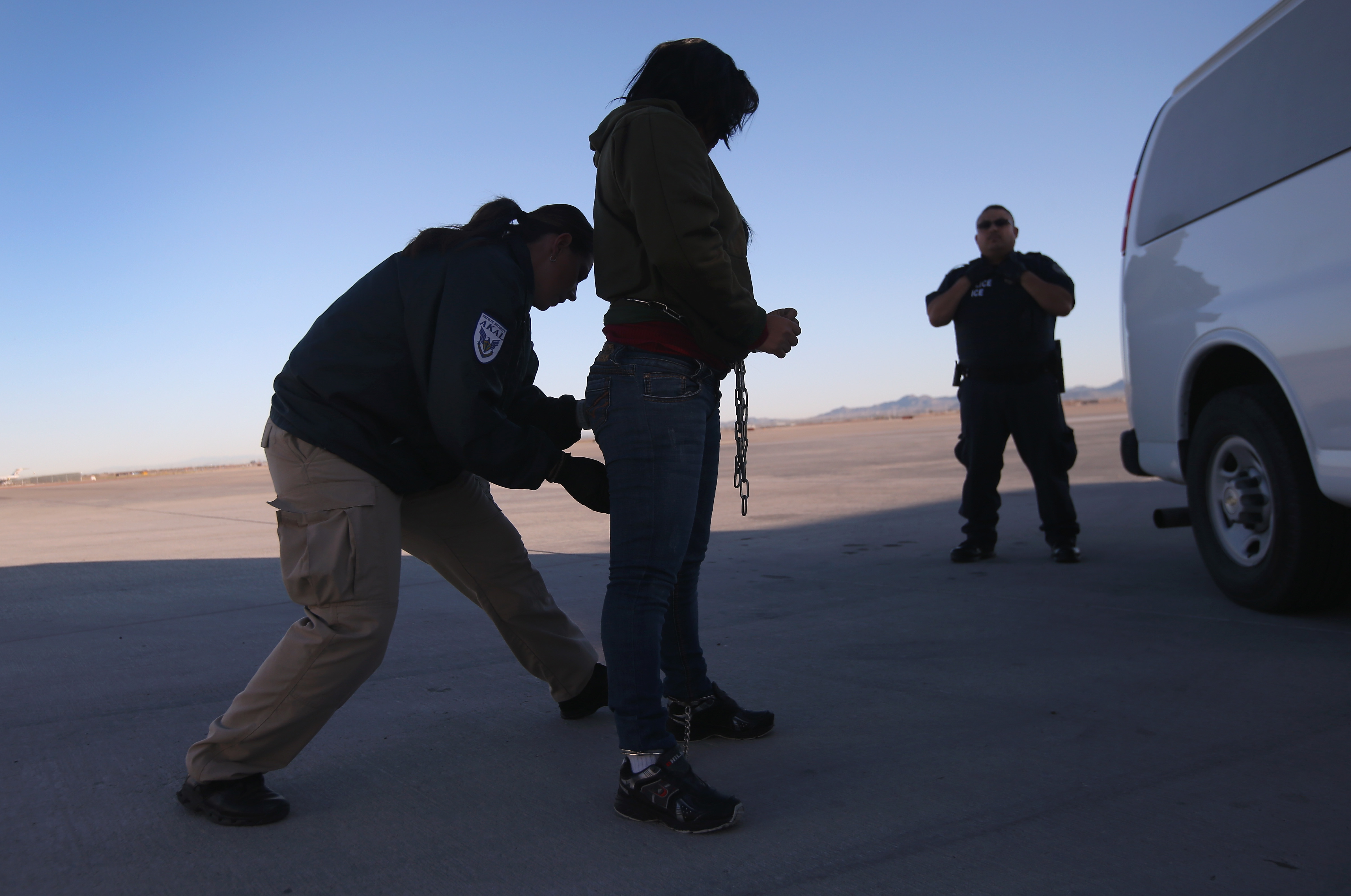A security contractor frisks a female immigration detainee from Honduras ahead of a deportation flight to San Pedro Sula, Honduras on February 28, 2013 in Mesa, Arizona. (Getty Images)