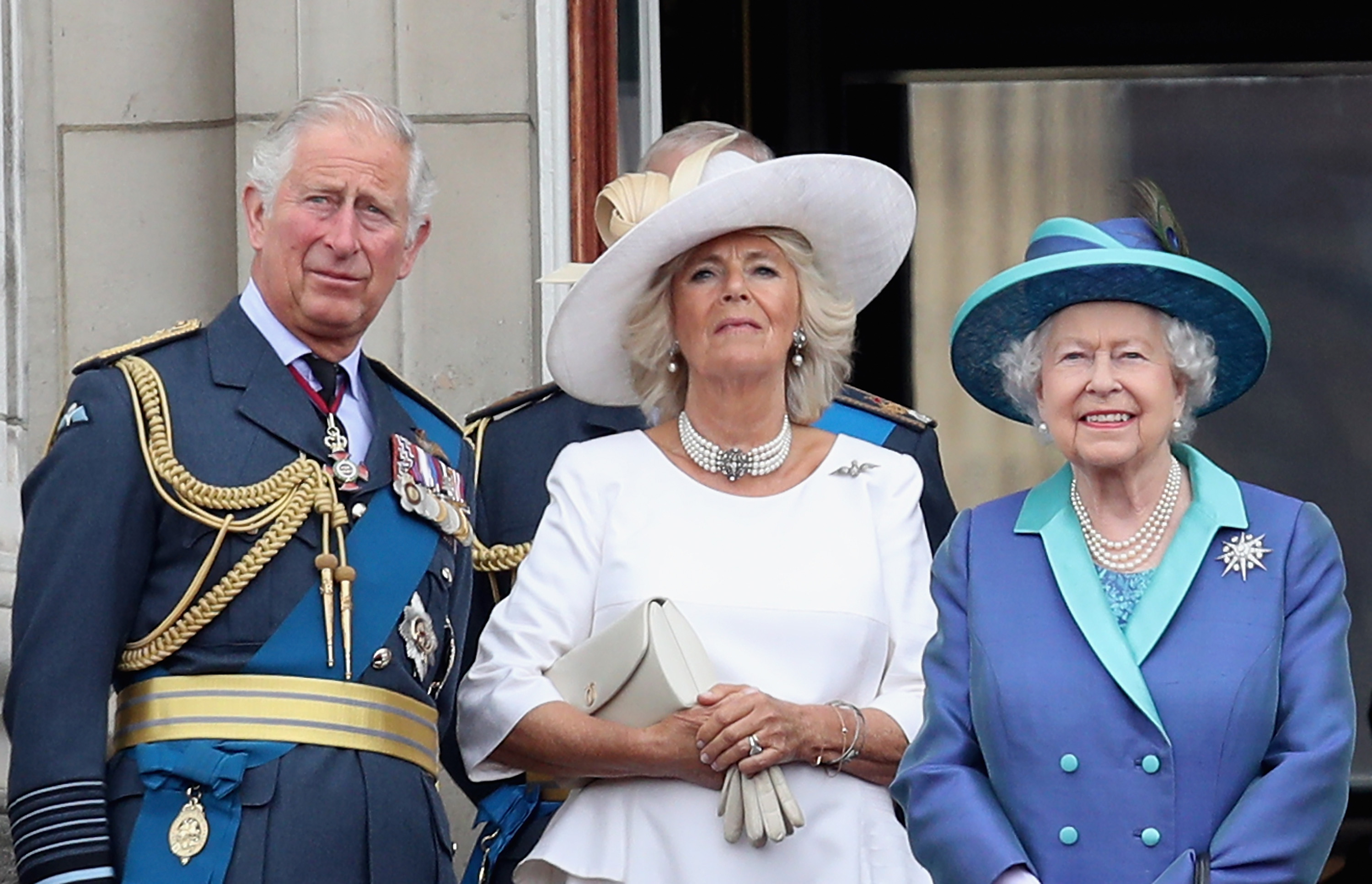 (L-R) Prince Charles, Prince of Wales, Camilla, Duchess of Cornwall, Queen Elizabeth II watch the RAF flypast on the balcony of Buckingham Palace, as members of the Royal Family attend events to mark the centenary of the RAF on July 10, 2018 in London, England.
