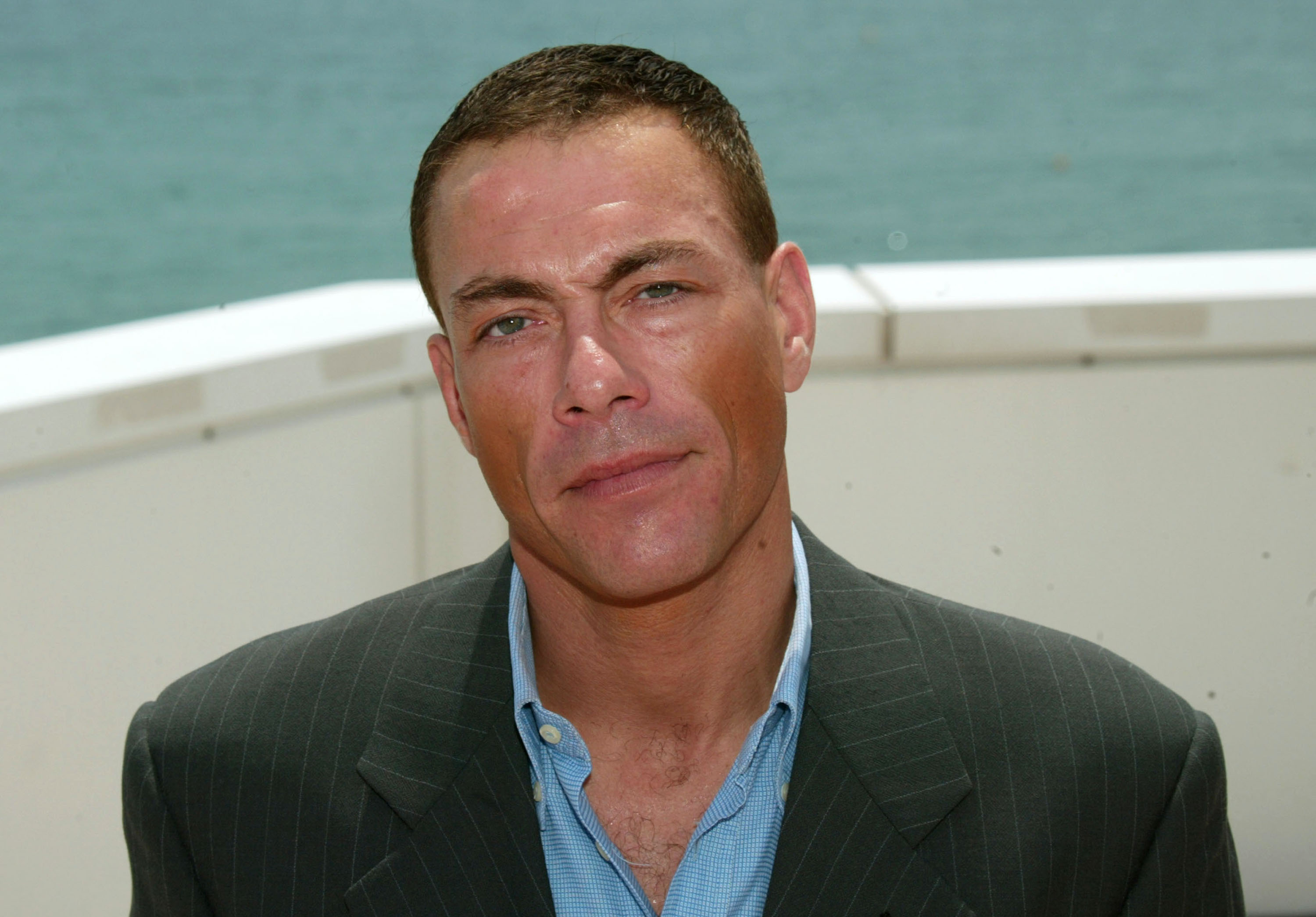 Actor Jean-Claude Van Damme poses during a photocall on the roof at the Noga Hilton during 56th International Cannes Film Festival 2003 on May 18, 2003 in Cannes, France.