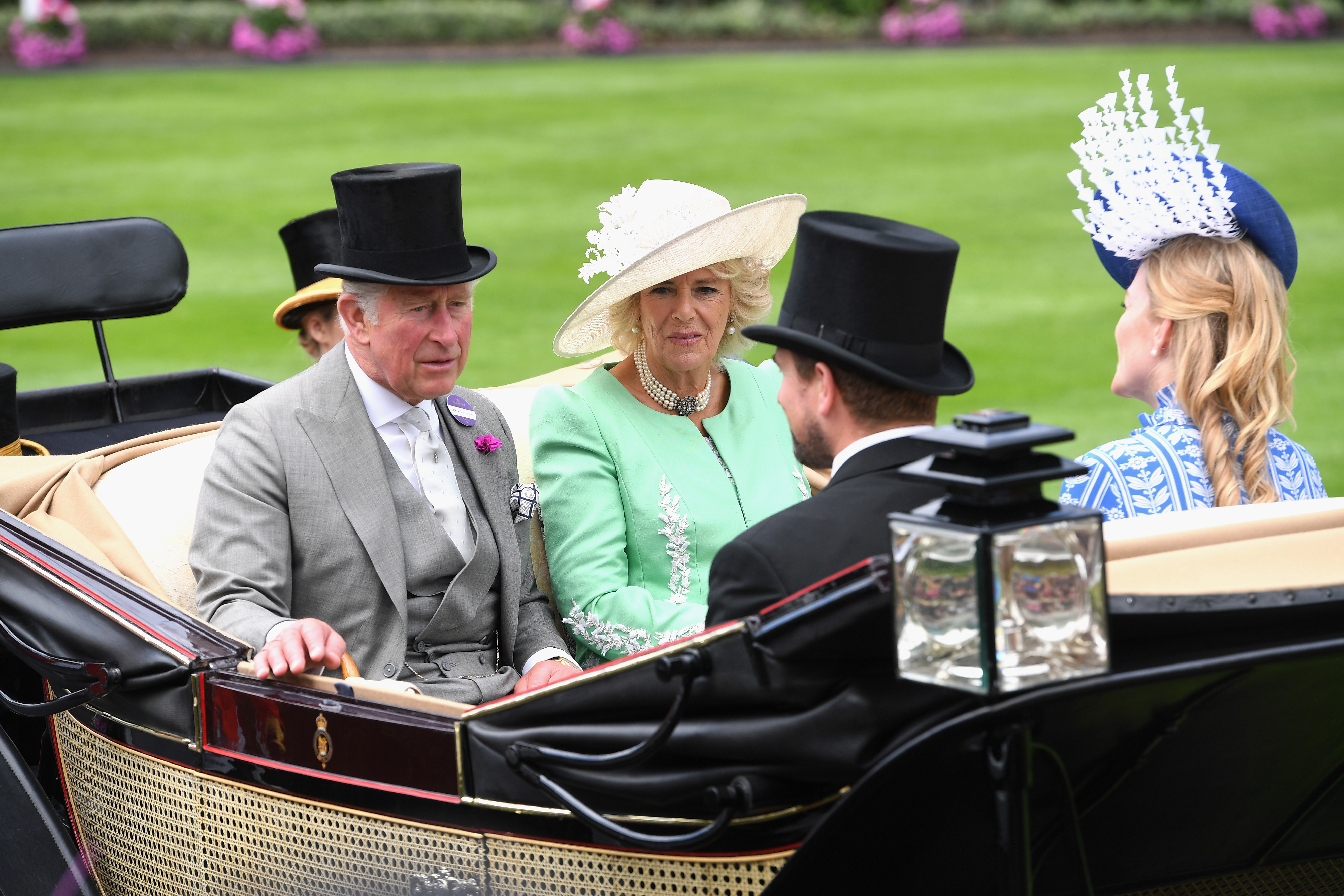 (L-R) Prince Charles, Prince of Wales, Camilla, Duchess of Cornwall, Peter Phillips and Autumn Phillips arrive in the royal procession on day 2 of Royal Ascot at Ascot Racecourse on June 20, 2018 in Ascot, England.