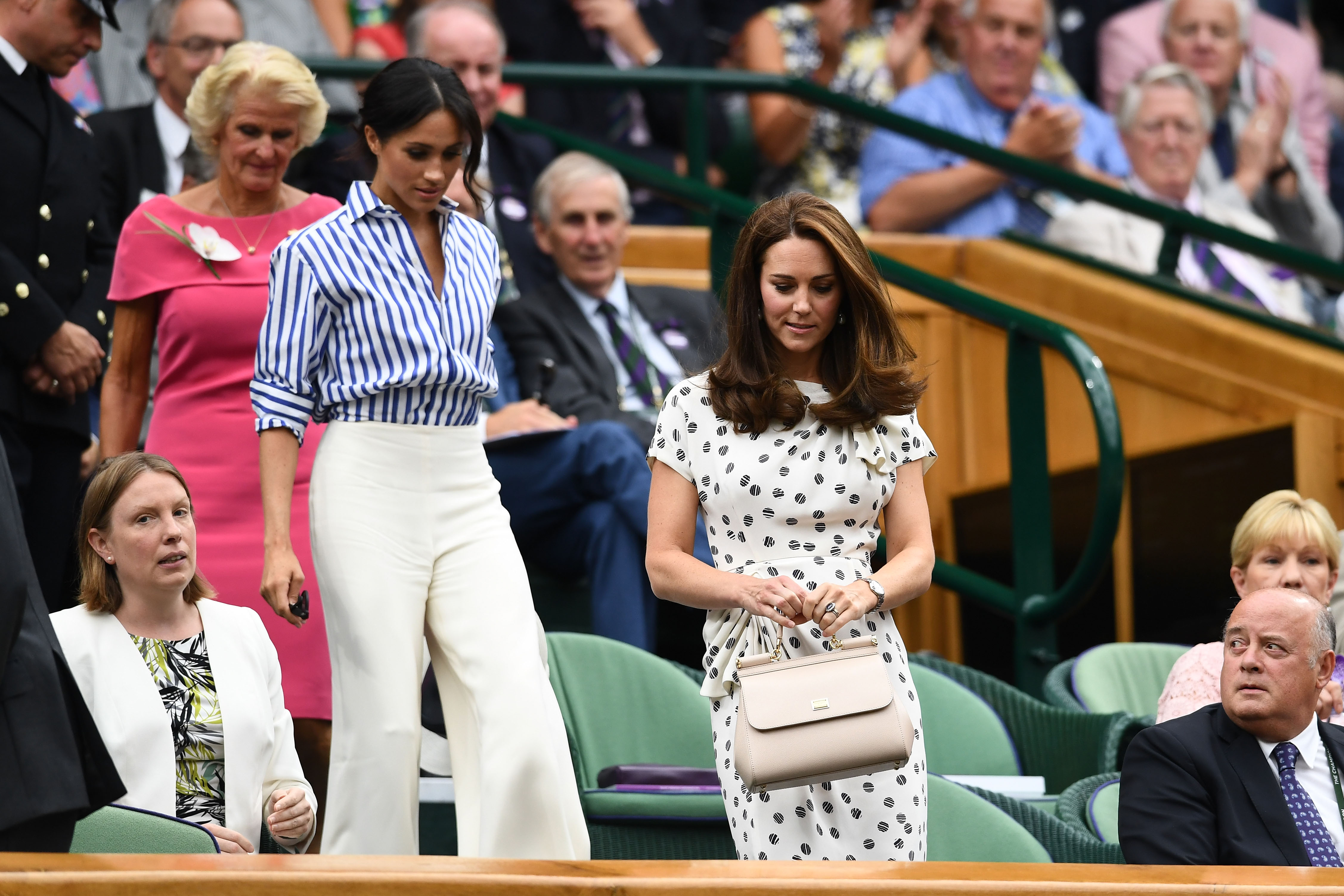 Kate and Meghan looked elegant as they kept their appearances and clothing simple. (Getty Images)