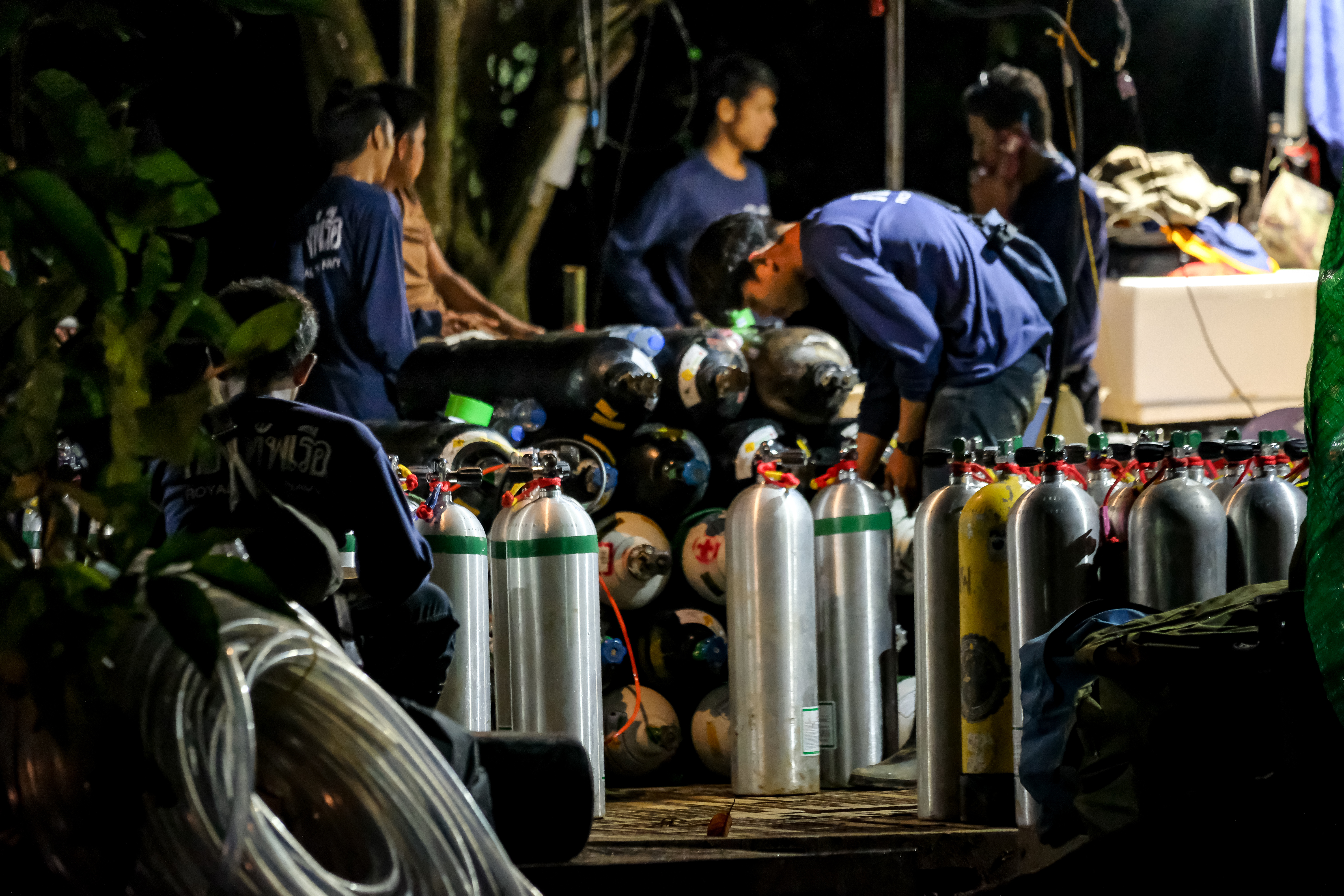 Diving cylinders are prepared at a makeshift camp at the entrance of Tham Luang Nang Non caves for the divers to continue the rescue operation for the 12 trapped children and their coach on July 06, 2018 in Chiang Rai, Thailand. (Getty Images)