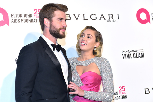 Liam Hemsworth (L) and Miley Cyrus attend the 26th annual Elton John AIDS Foundation's Academy Awards Viewing Party at The City of West Hollywood Park. (Getty Images)