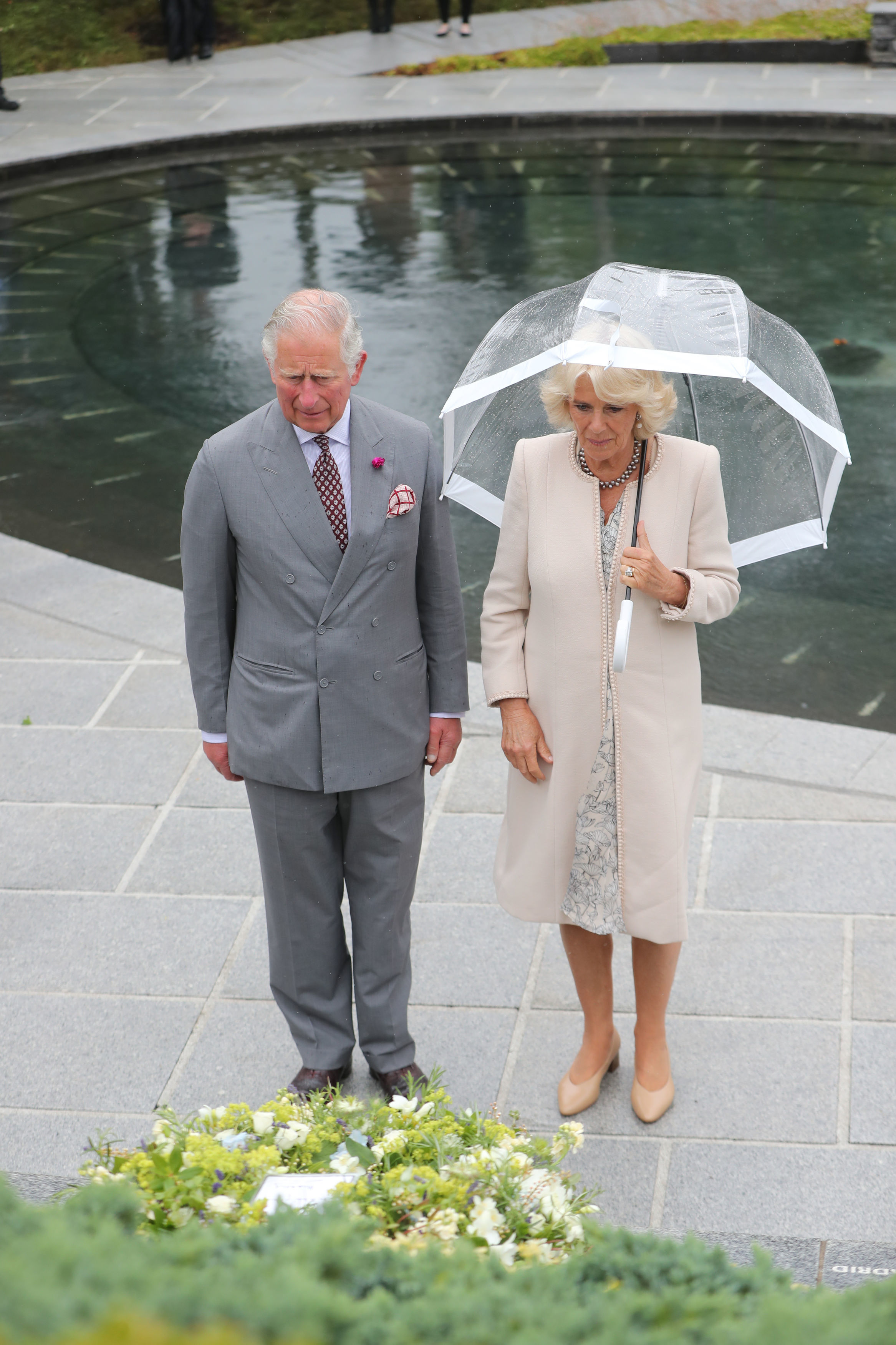 Prince Charles, Prince of Wales and Camilla, Duchess of Cornwall lay a wreath during a visit to the Omagh Bomb memorial on June 13, 2018 in Omagh, Northern Ireland. The Prince of Wales and Duchess of Cornwall are paying a four day visit to Northern Ireland and the Republic of Ireland.