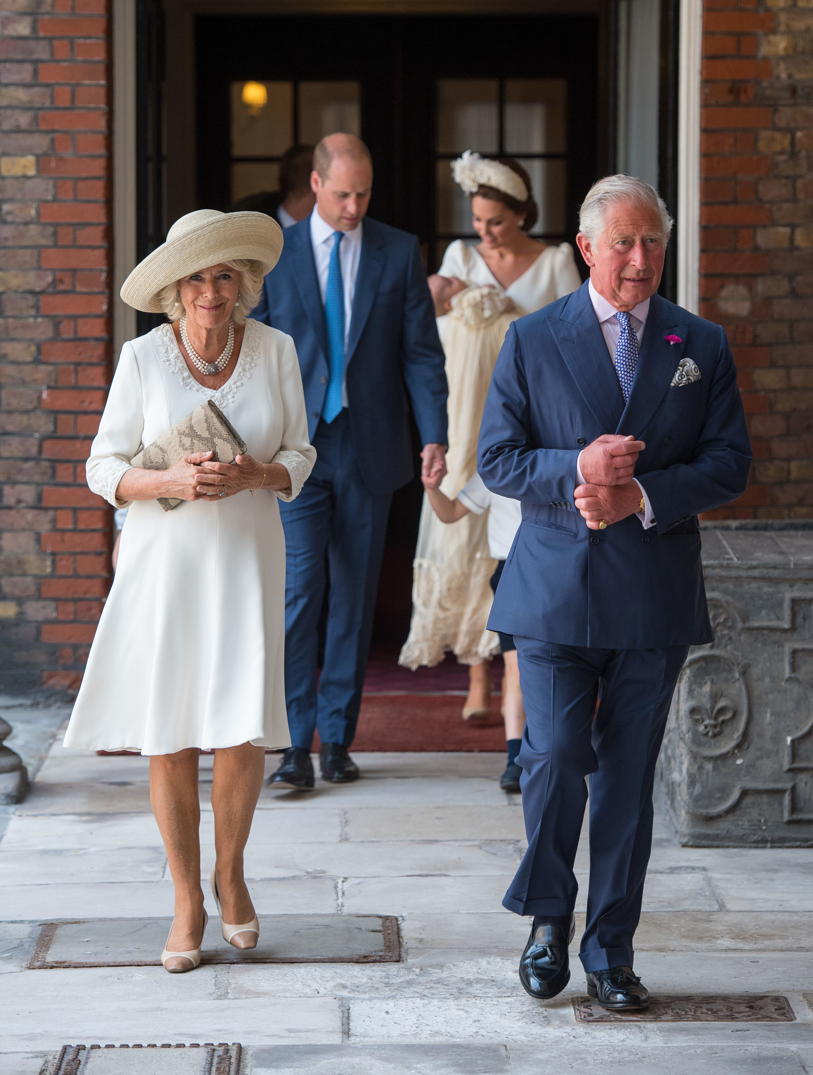 Britain's Prince Charles, Prince of Wales (R) and Britain's Camilla, Duchess of Cornwall attend the christening of Prince Louis at the Chapel Royal, St James's Palace on July 09, 2018 in London, England.