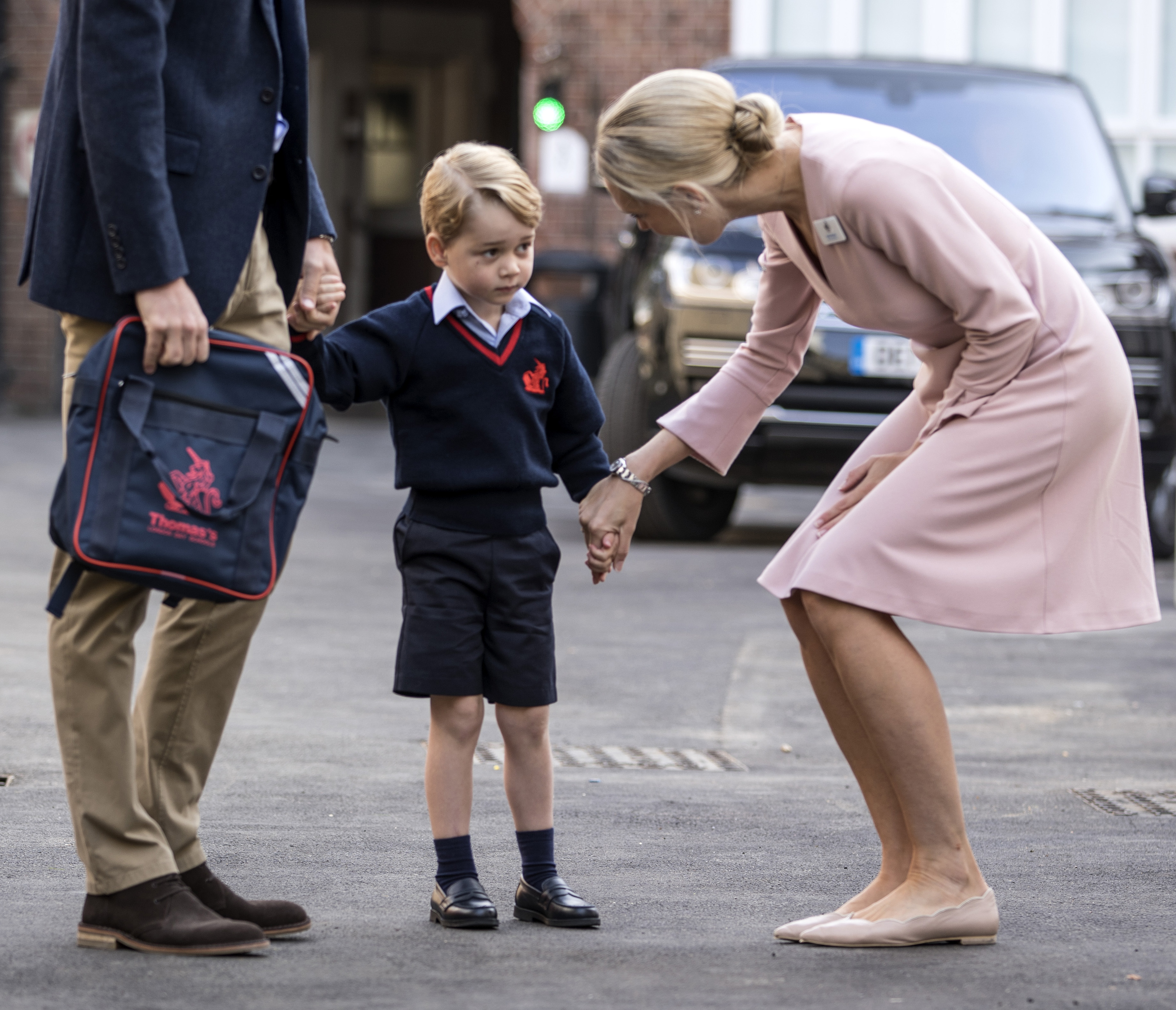 Prince George of Cambridge arrives for his first day of school with his father Prince William, Duke of Cambridge as they are met Head of the lower school Helen Haslem at Thomas's Battersea on September 7, 2017 in London, England. (Getty Images)