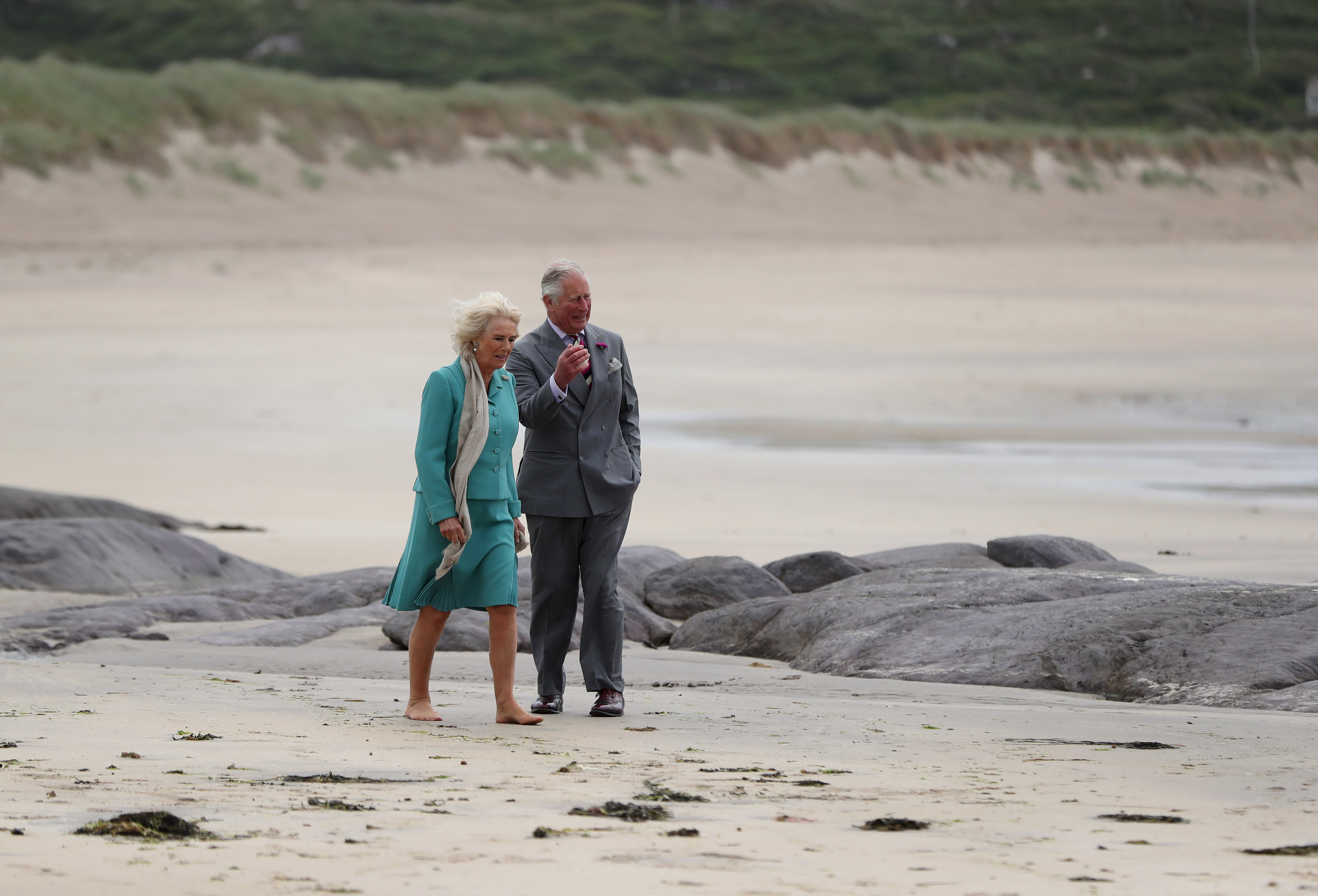 Prince Charles, Prince of Wales and Camilla, Duchess of Cornwall walk on Derrynane beach in Co Kerry during thier tour of Northern Ireland and the Republic of Ireland on June 15, 2018 in Derrynane, Ireland.
