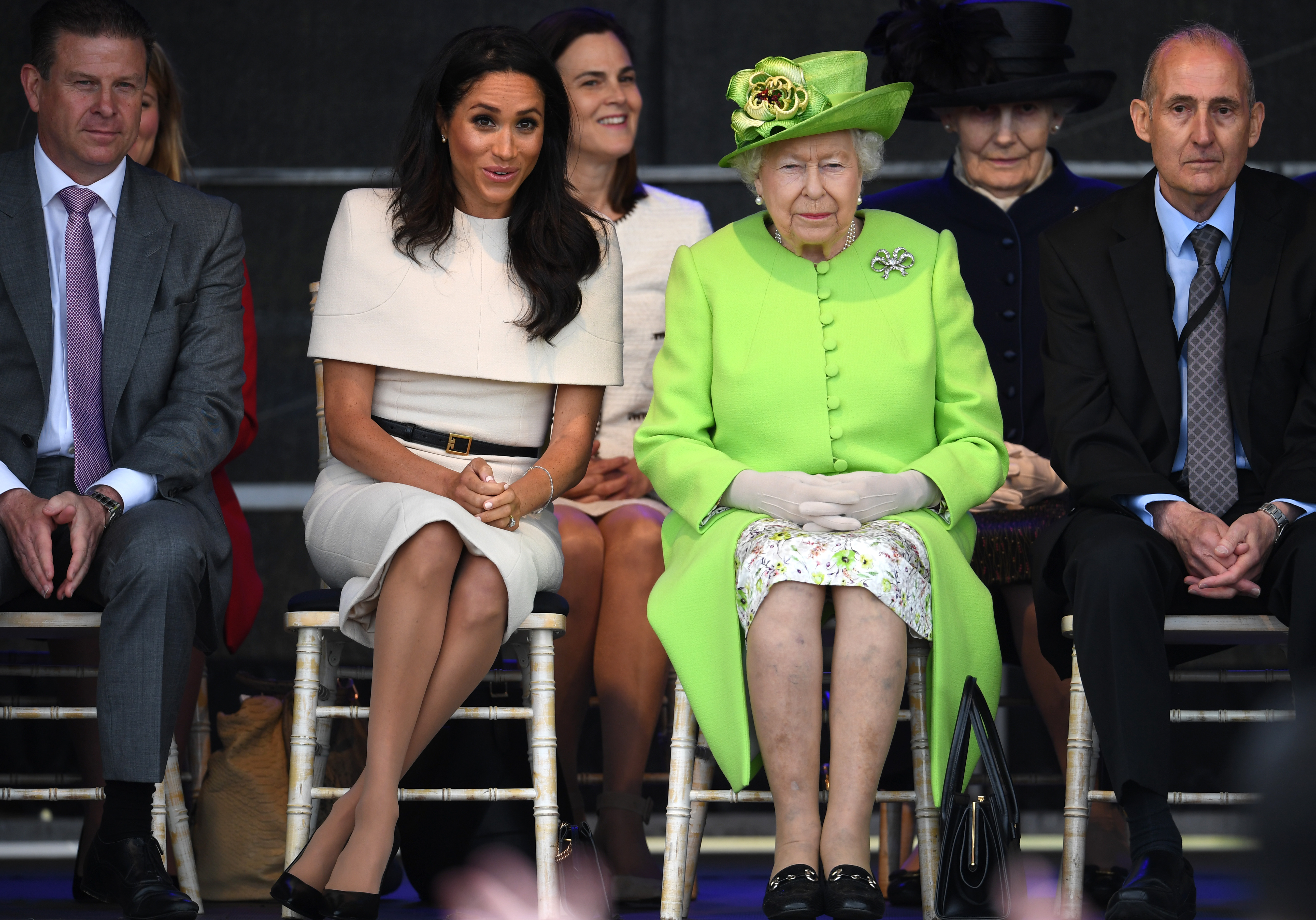 Meghan Markle doing the 'Duchess Slant' while on royal duty with the Queen (Source: Getty Images)